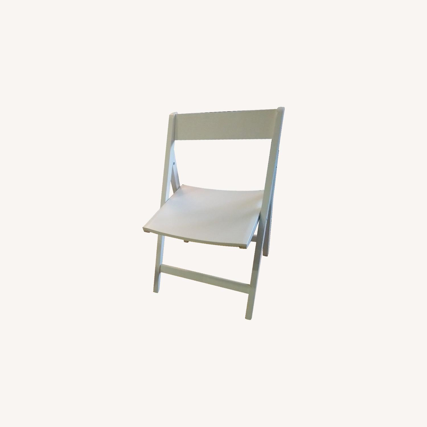 Two Rarely Used Folding Wooden Chairs - image-0