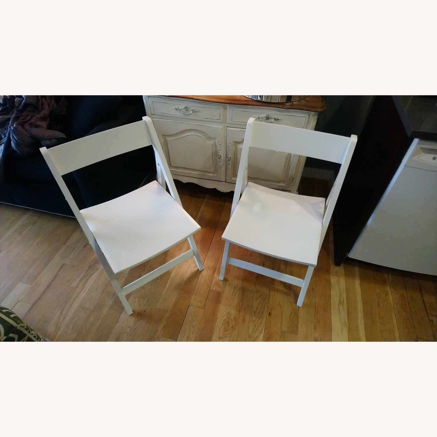 Two Rarely Used Folding Wooden Chairs