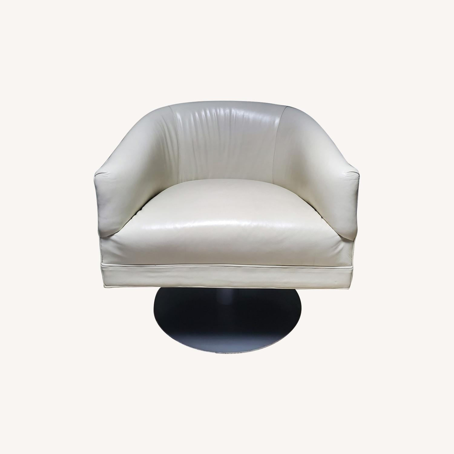 Mitchell Gold ivory leather swivel chair - image-0