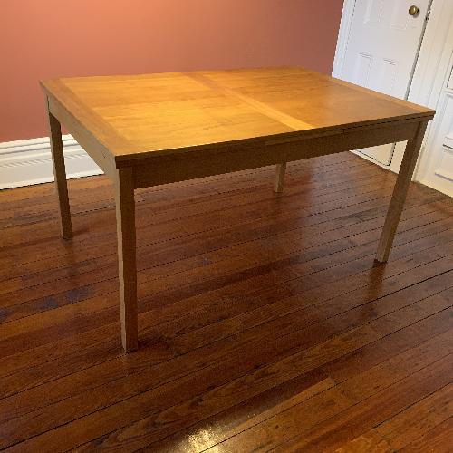 Used Solid oak dining table with sliding extender leaves for sale on AptDeco