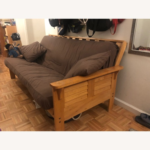 Used Wood futon with armrests for sale on AptDeco