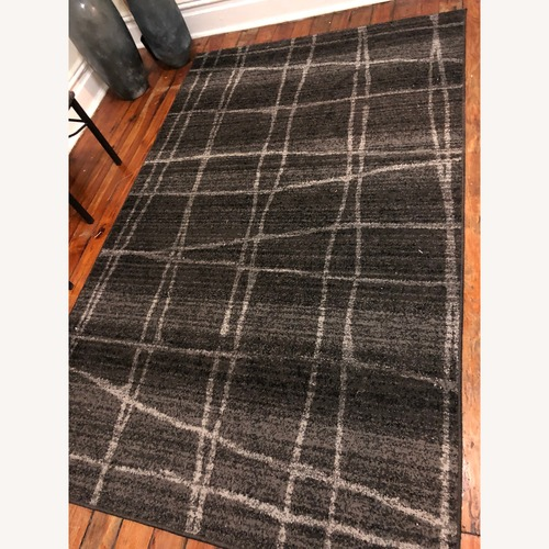 Used Black/Grey Checker Rug for sale on AptDeco