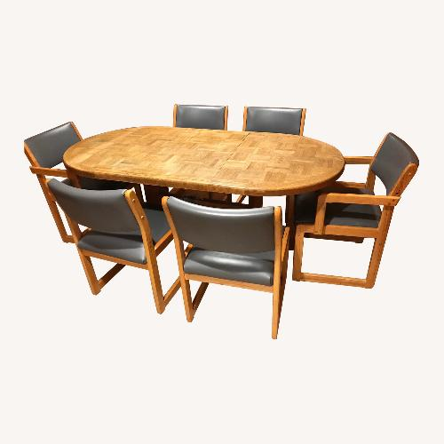 Used Parquet Dining Table adjustable with leaf for sale on AptDeco