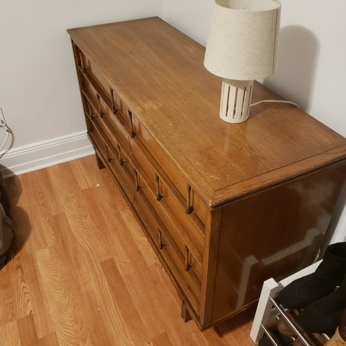 Used Mid Century Modern 8 drawer dresser with brass+wood pulls for sale on AptDeco