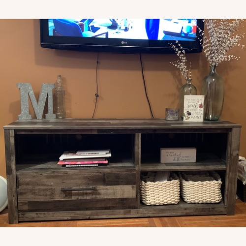 Used Ashley Derekson TV stand for sale on AptDeco
