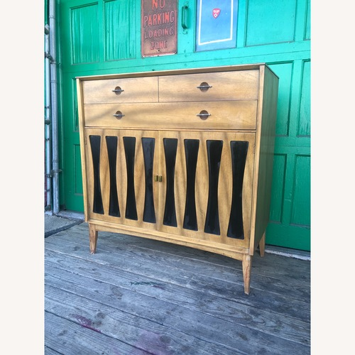 Used Mid century Highboy dresser with black vinyl accents for sale on AptDeco