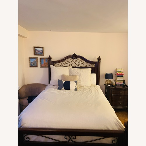 Used Raymour & Flanigan Queen Bed Wood Frame for sale on AptDeco