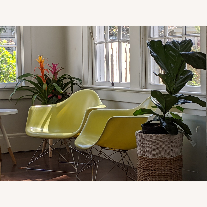 Pair of Eames Fiberglass Arm Shell Chairs
