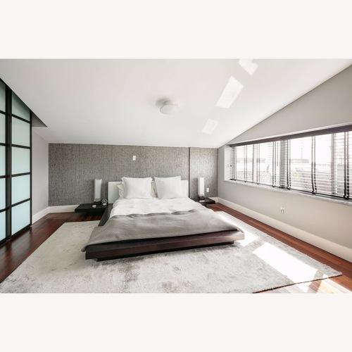 Used Modern platform bed with side tables for sale on AptDeco