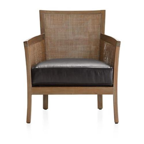 Used Crate & Barrel Rattan Chair with Leather Cushion for sale on AptDeco