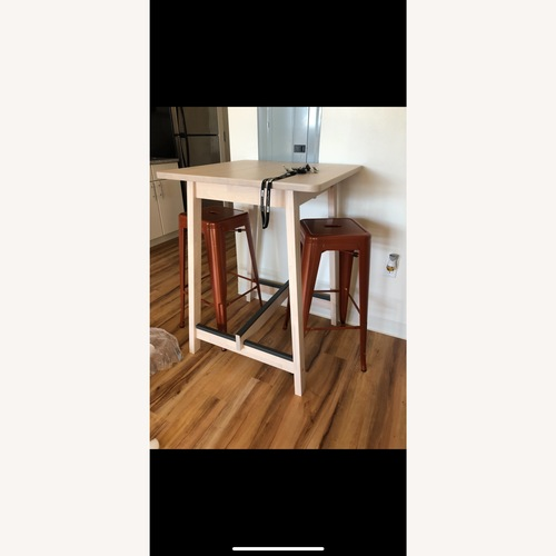Used Ikea Bar Table with Stools for sale on AptDeco