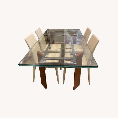 Used Calligaris Tower Extendable Table with Anais Leather Chairs for sale on AptDeco