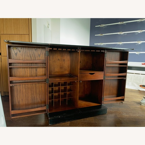 Used CISCO Brothers Fold Out Bar Cabinet for sale on AptDeco