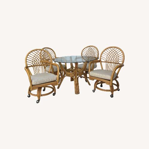 Used Rattan Dinette Set Glass Top Table & Four Chairs for sale on AptDeco