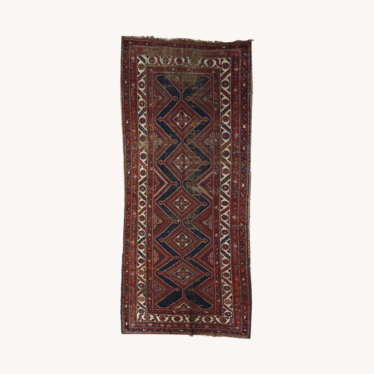 Handmade Antique Distressed Persian Shiraz Rug - image-0