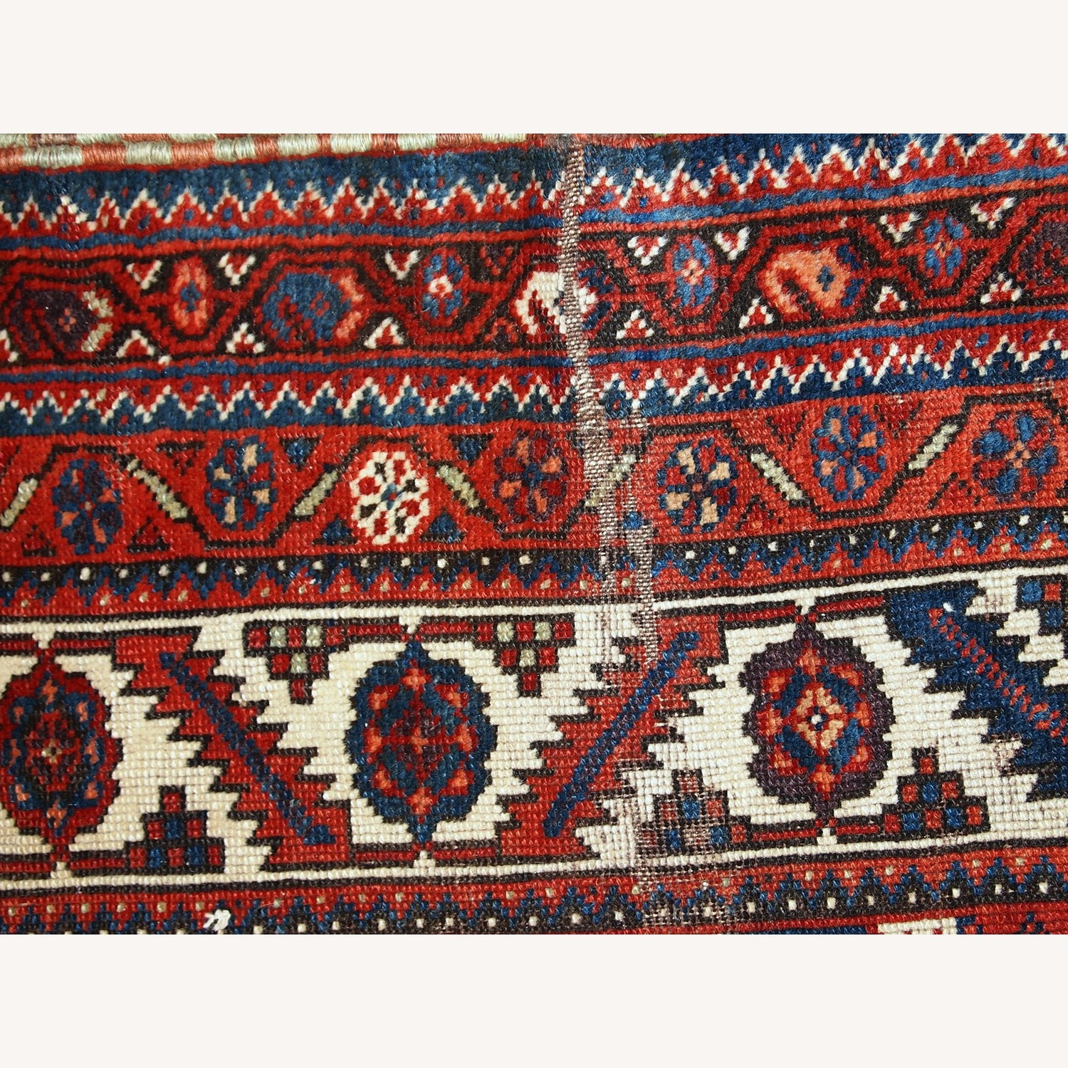 Handmade Antique Distressed Persian Shiraz Rug - image-3