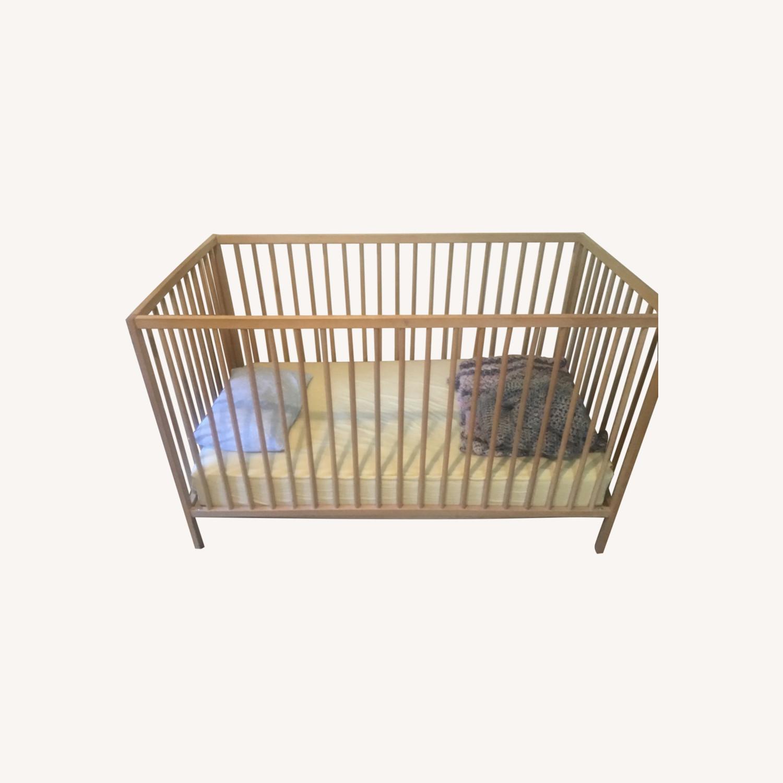 Blond Wood Crib - image-0