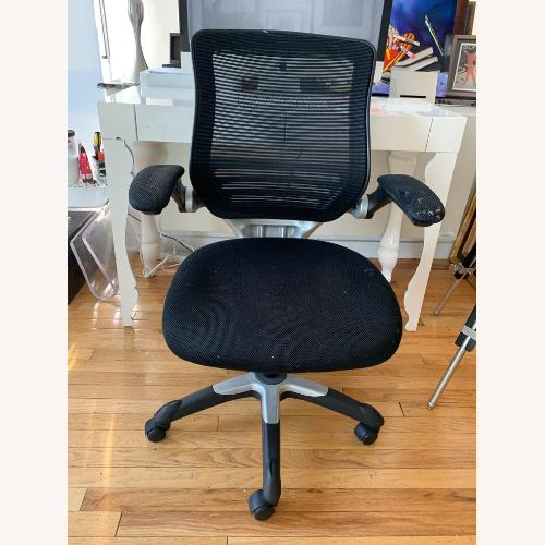 Used Black and Silver Swivel Chair for sale on AptDeco