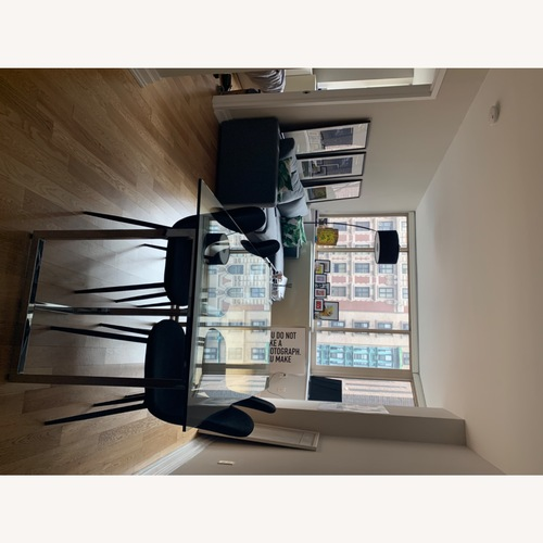 Used CB2 Glass Table Top Dining Table for sale on AptDeco
