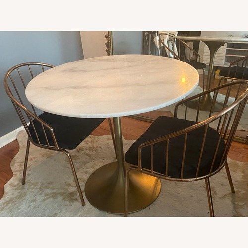 Used World Market Marble Top Tulip Dining Table for sale on AptDeco