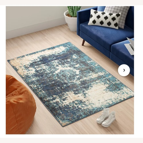 Used Montross Oriental Blue Area Rug for sale on AptDeco