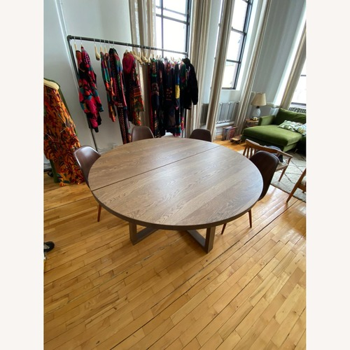 Used Round Dinner Table for sale on AptDeco