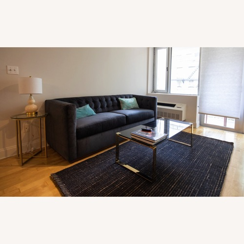 Used Metal and Black Tempered-glass Coffee Table for sale on AptDeco