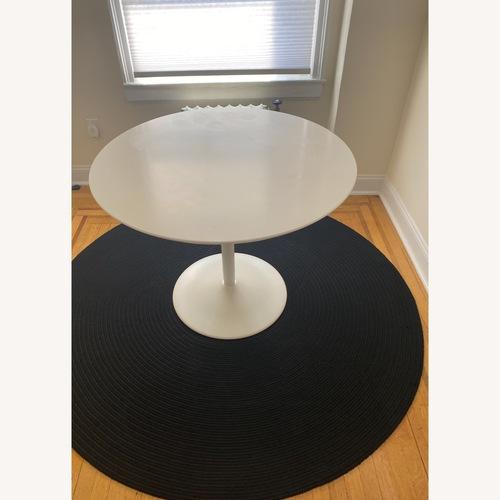 Used Round Black Rug for sale on AptDeco