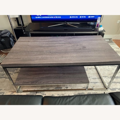 Used Rooms To Go Dark Grey Wood and Metal Coffee Table for sale on AptDeco