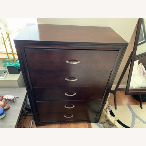 Used Rooms To Go Dark Wood Dresser for sale on AptDeco