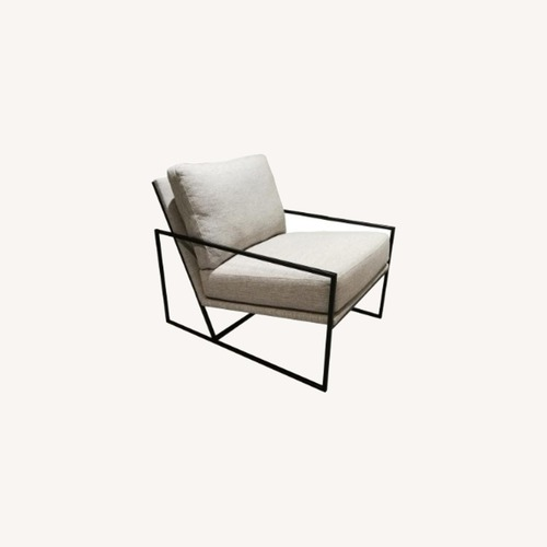 Used Armchair with Black Metal Frame for sale on AptDeco