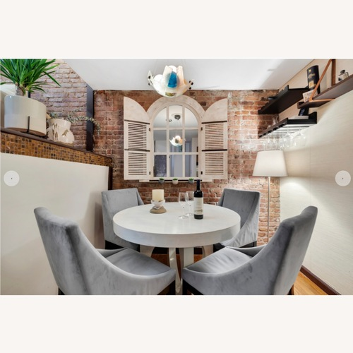 Used West Elm Round Dining Table & 4 Upholstered Chairs for sale on AptDeco