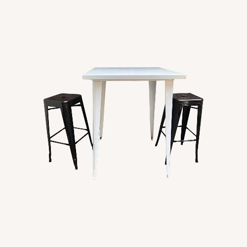 Used Tolix Table 2 Bar Stools for sale on AptDeco