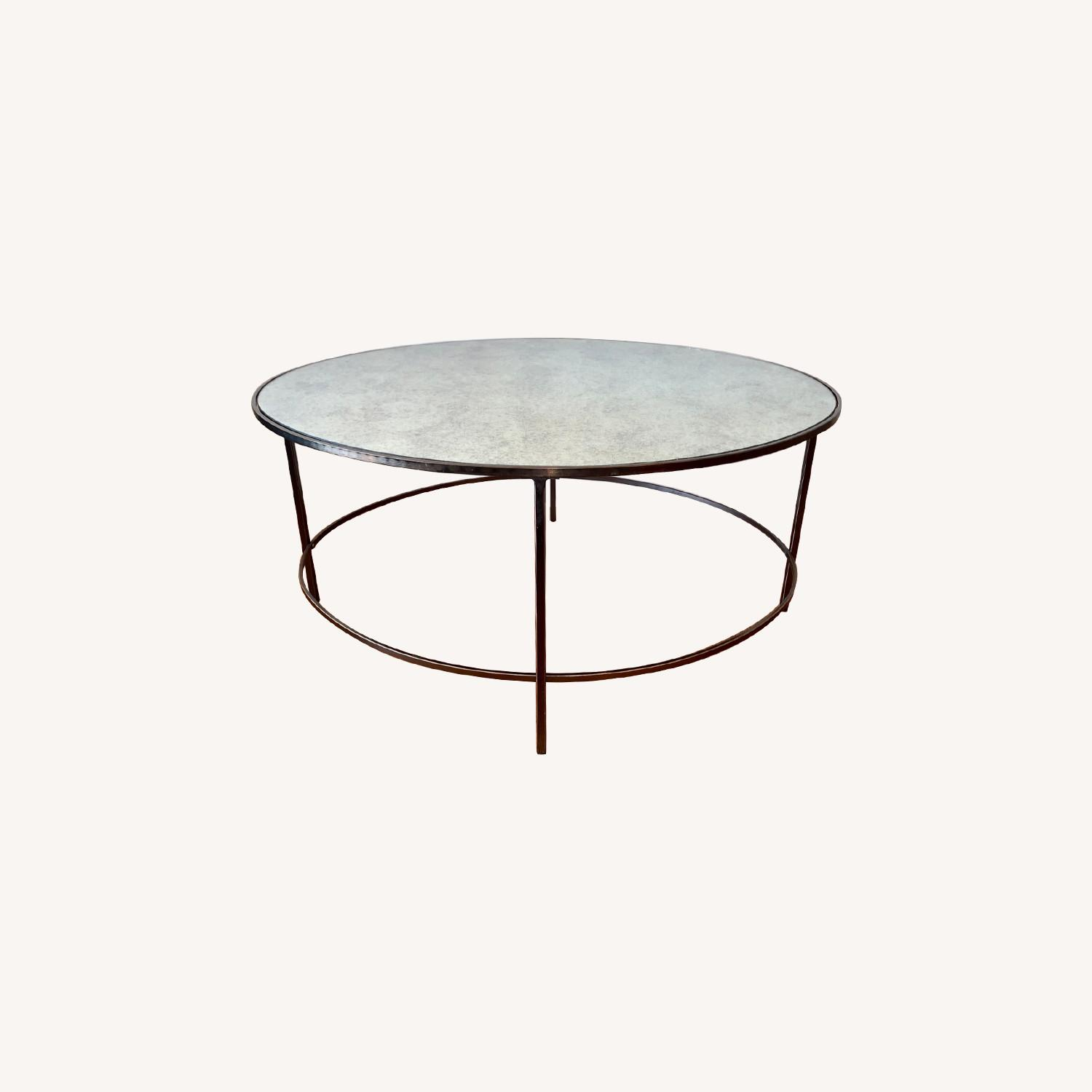 Picture of: West Elm Antiqued Mirror Oval Coffee Table Aptdeco