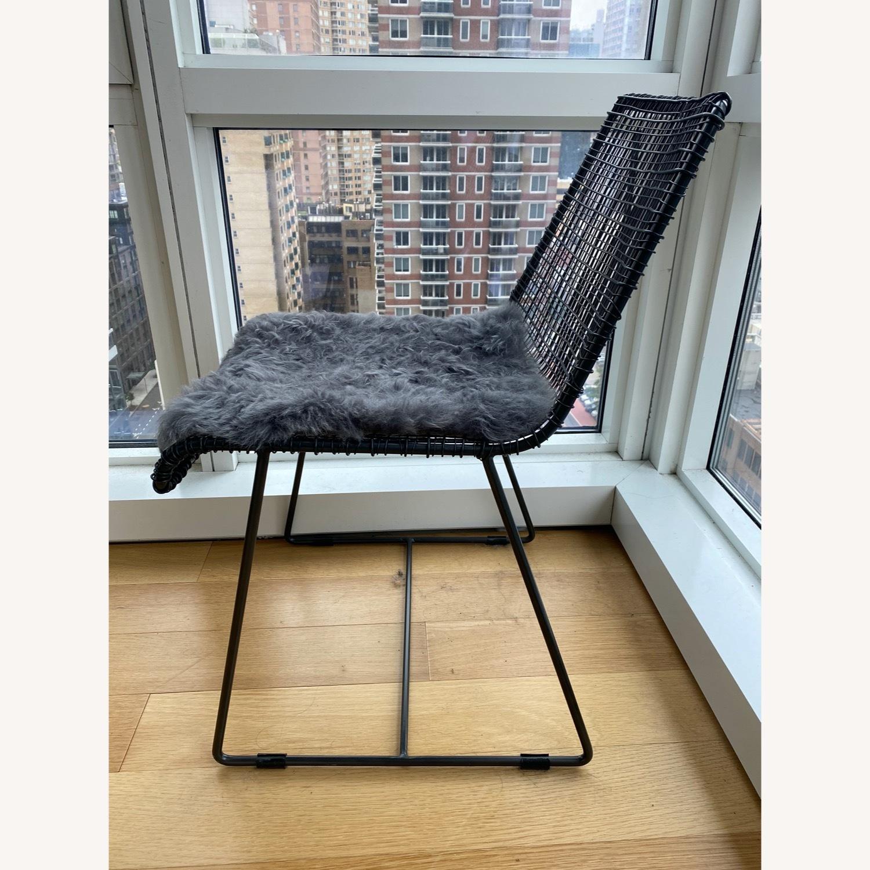 CB2 Reed Chair and Icelandic Sheepskin Cushion - image-3