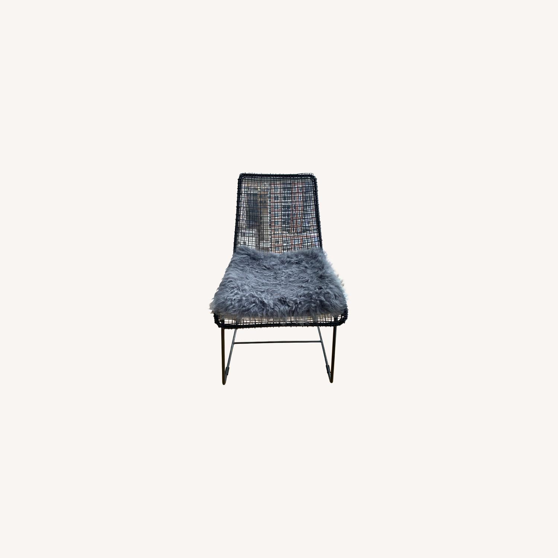 CB2 Reed Chair and Icelandic Sheepskin Cushion - image-0
