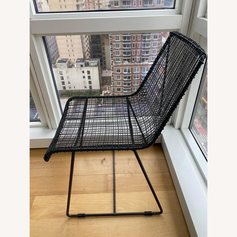 CB2 Reed Chair and Icelandic Sheepskin Cushion - image-4