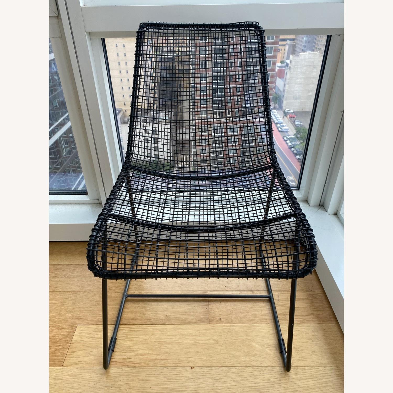 CB2 Reed Chair and Icelandic Sheepskin Cushion - image-2