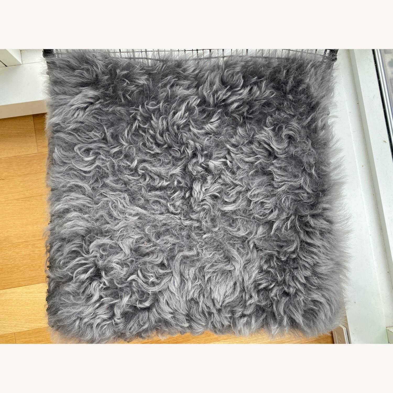 CB2 Reed Chair and Icelandic Sheepskin Cushion - image-5