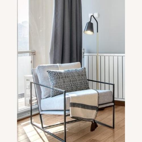 Used Armchair with Black Metal Frame for sale on AptDeco