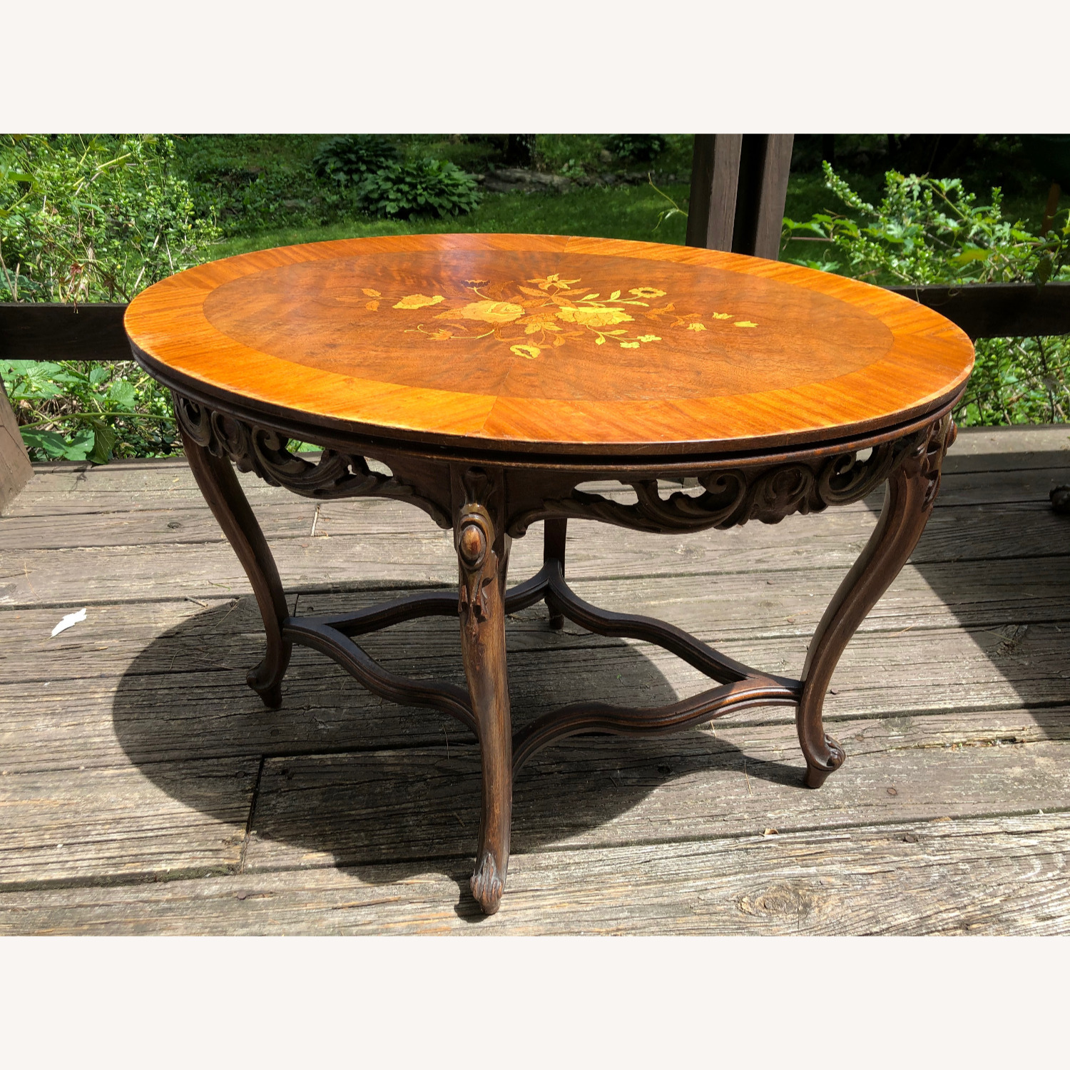 Picture of: Mahogany Flowered Oval Glasstop Coffee Table Aptdeco
