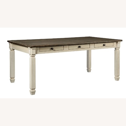 Used Ashley Furniture Two-Toned Dining Room Table for sale on AptDeco