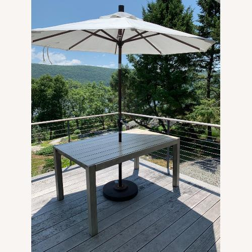 Used CB2 Dockside Table with Umbrella for sale on AptDeco