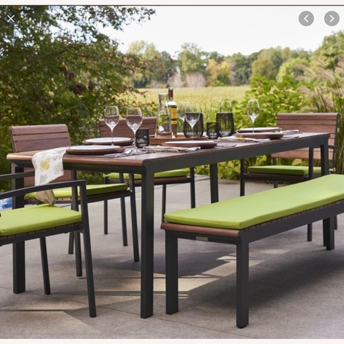 Used Crate & Barrel Outdoor Rocha Dining Table for sale on AptDeco