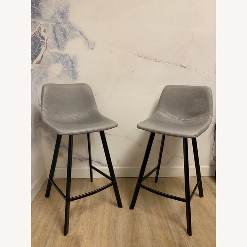 Used Scandinavian Designs Stools with Baseball Stitching (2) for sale on AptDeco