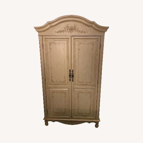 Used Fortunoff Natural Wood Armoire for sale on AptDeco