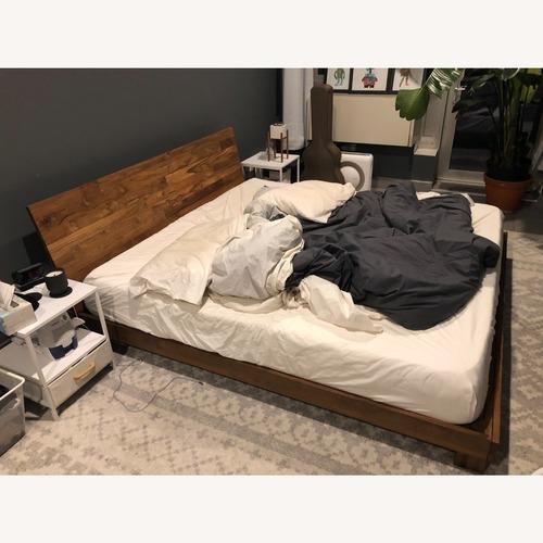 Used CB2 Teak King-size Bed Frame for sale on AptDeco