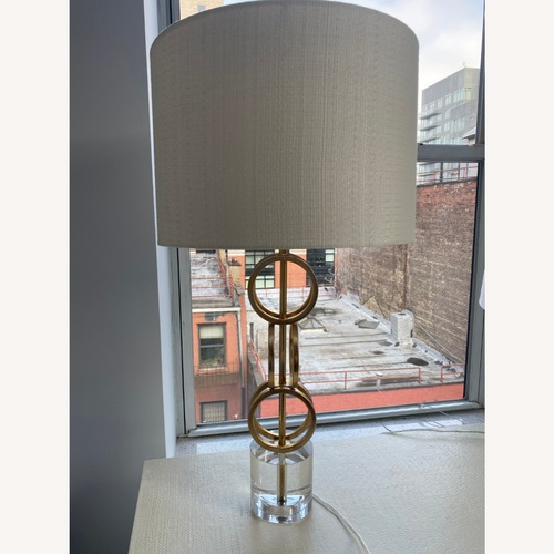 Used Surya Gold, White, and Glass Lamp for sale on AptDeco