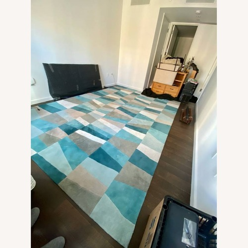 Used Surya Cosmopolitan 9' x 13' Teal Mid Century Rug for sale on AptDeco