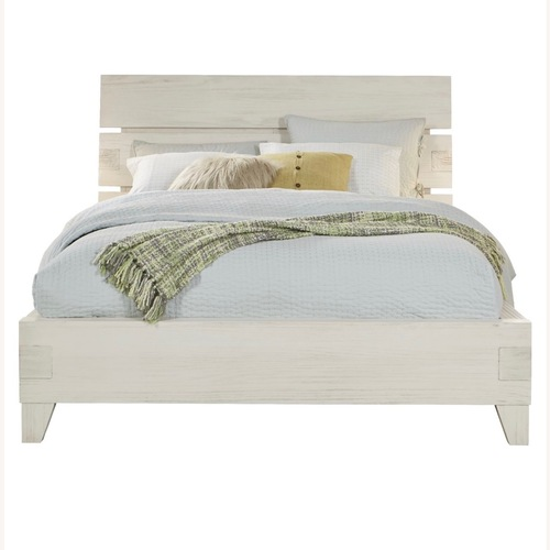 Used Rooms to Go Natural Queen Bed Frame for sale on AptDeco